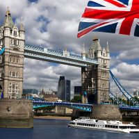 15400542 - tower bridge with flag of england, london